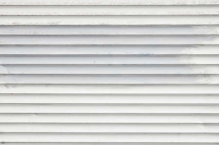 blinds: White dirty horizontal metal window roller shutter blinds background with gray paint strokes