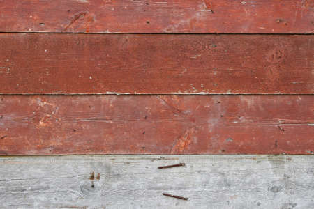 unpainted: Red vintage aged painted wooden panel with horizontal planks texture background with one unpainted raw plank Stock Photo