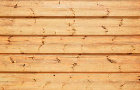 unpainted: Unpainted lacquered pine wooden planks and bars wall texture Stock Photo