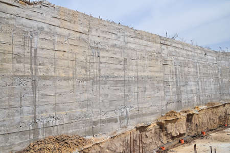 impress: Concrete wall texture with wooden pattern impress from wooden form board shuttering and with sags of cement at construction site Stock Photo