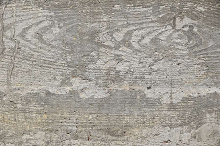 impress: Concrete wall texture with wooden pattern impress from wooden form board shuttering and with sags of cement, close up Stock Photo