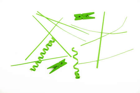 trumpery: Small things matter, mixed colorful green paper pieces and wooden painted clothespins isolated on white background