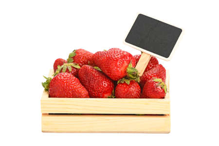 white chalk: Mellow fresh red summer strawberries in wooden tray box with chalk blackboard price tag sign isolated on white background