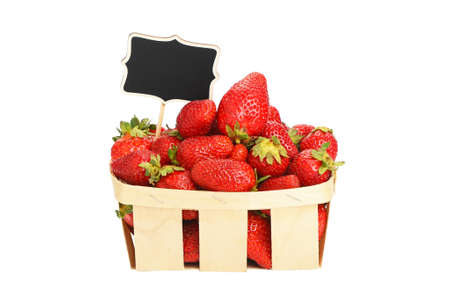 mellow: Mellow fresh red summer strawberries in wooden wicker basket with chalk blackboard price tag sign isolated on white background, side view