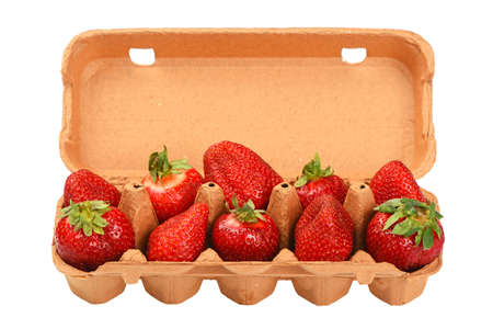 mellow: Red mellow strawberry in open brown carton egg carrier container tray isolated on white background