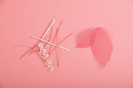 trumpery: Pink skeleton leaves and paper cuts, stripes and spirals over design paper background