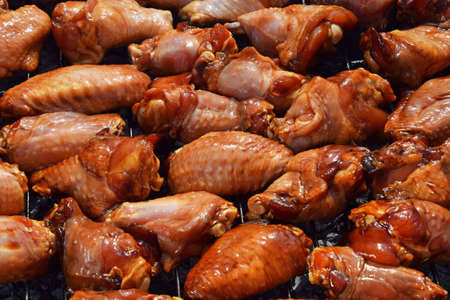 sizzle: Chicken buffalo or teriyaki sauce raw wings cooked grilled on bbq smoke grill
