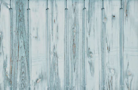 scaling: Light blue teal vintage old grunge aged painted wooden panel with vertical planks texture background with paint scaling