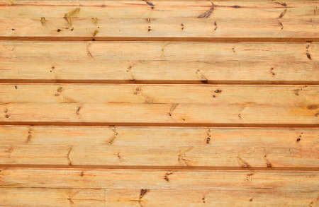 knotty: Unpainted lacquered pine wooden planks and bars wall texture Stock Photo