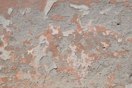 daub: Background texture of old pink painted plaster gray cement wall with grunge stains and paint peeling