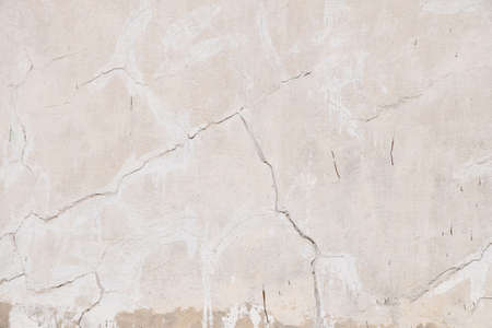 parget: Background texture of old beige pink painted plaster wall with cracks and grunge repair stains