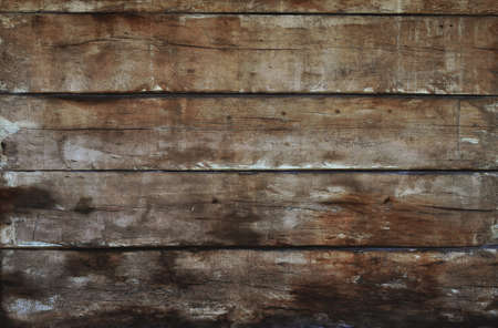 unpainted: Old dark grunge vintage brown wooden panel texture background with horizontal unpainted aged planks, cracks, stains and gaps Stock Photo