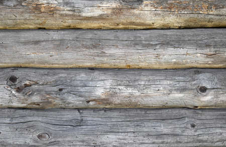 unpainted: Old antique unpainted wooden vintage cracked pale logs wall of blockhouse, texture background Stock Photo