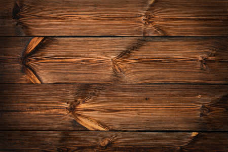 Brown vintage old wooden panel texture background with horizontal unpainted aged planks and gaps and darker shaded border