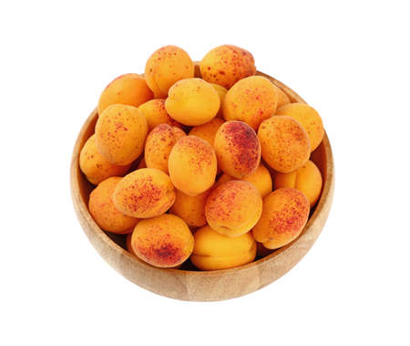 mellow: Mellow ripe fresh apricots with in big wooden bowl isolated on white background, close up, high angle view