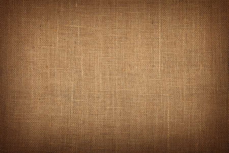 jute texture: Natural brown burlap jute sackcloth bagging canvas texture pattern background with dark shade border
