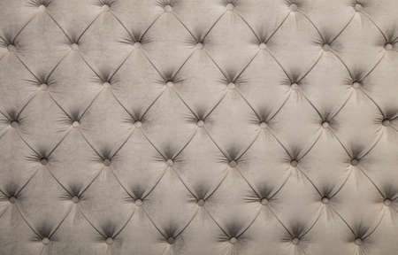 soft textile: White beige velvet capitone textile background, retro Chesterfield style checkered soft tufted fabric furniture diamond pattern decoration with buttons, close up
