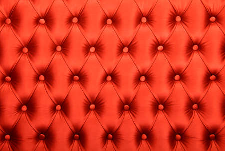 button tufted: Red capitone textile background, retro Chesterfield style checkered soft tufted fabric furniture diamond pattern decoration with buttons, close up