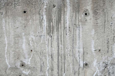 Concrete wall texture with aperture holes, sags and runs of cement at unfinished construction site Stock Photo