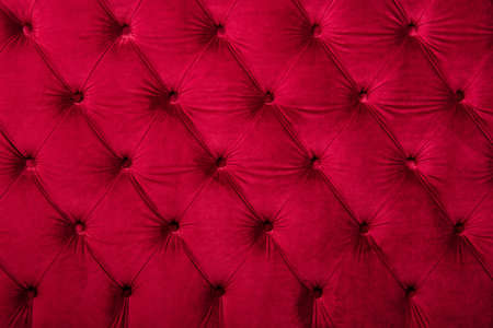 button tufted: Red burgundy velvet capitone textile background, retro Chesterfield style checkered soft tufted fabric furniture diamond pattern decoration with buttons, close up Stock Photo