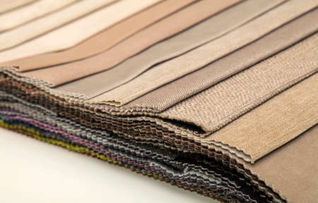 gamma tone: Colorful beige fabric samples swatch in textile catalogue palette, selection of different colors and textures range to choose for interior design and furniture decoration