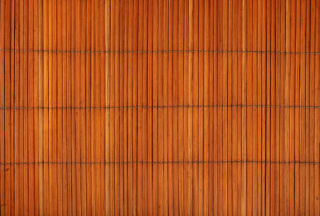 matting: Orange brown vintage natural wooden bamboo mat background texture with vertical planks, close up Stock Photo