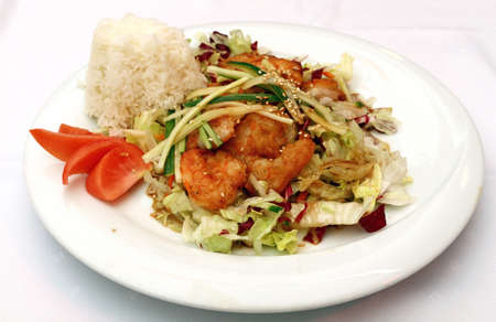 personal perspective: Roasted king shrimps prawns with steamed rice and fresh vegetable salad on white plate, the meal of Chinese cuisine, close up, high angle view, personal perspective