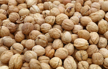 nutshells: Whole walnuts with brown nutshells on retail market, close up, background, high angle view Stock Photo