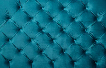 button tufted: Blue teal velvet capitone textile background, retro Chesterfield style checkered soft tufted turquoise fabric furniture diamond pattern decoration with buttons, close up