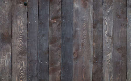 Old vintage vieilli grunge brun foncé parquet planches texture de fond avec des taches, des ongles et de la poussière des ordures bruyant