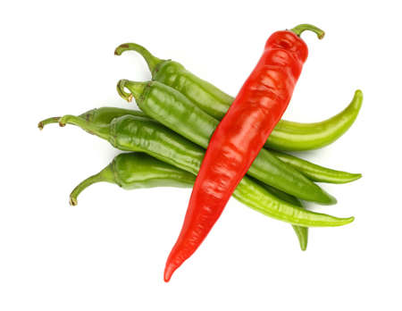deviation: Group of fresh green jalapeno chili peppers and one red crossing above, isolated on white background, close up, elevated top view, directly above Stock Photo