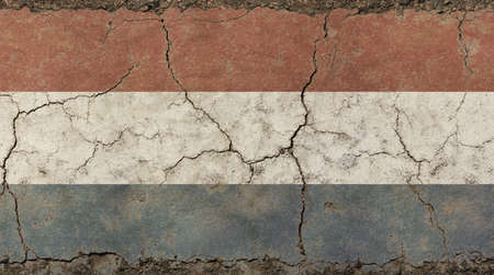 Old grunge vintage dirty faded shabby distressed Dutch (Holland, Kingdom of the Netherlands) national flag background on broken concrete wall with cracks
