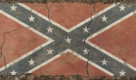 Old grunge vintage dirty faded shabby distressed American US Confederate South historical flag background on broken concrete wall with cracks
