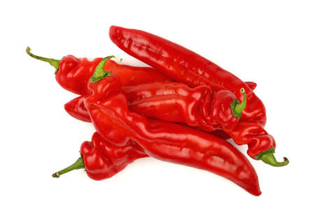 Group of several whole fresh red sweet paprika peppers isolated on white background, close up, elevated top view, directly above Stock Photo