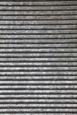 Corrugated goffered gray galvanized metal sheet background texture (washboard, skiffle board)