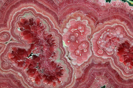 Rhodochrosite pink rose red stone is a manganese carbonate mineral with chemical composition MnCO3
