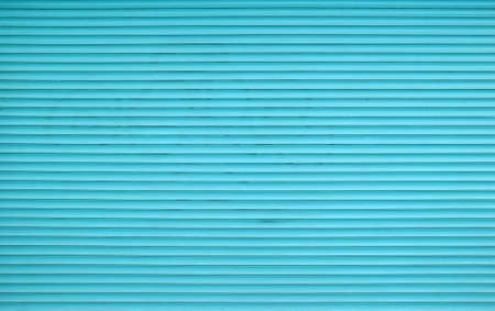 Teal blue painted horizontal metal window roller shutter blinds or garage doors background texture Stock Photo