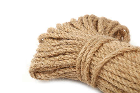 One big coil skein of natural brown twine hessian burlap jute rope isolated on white background, close up, high angle view Stock Photo