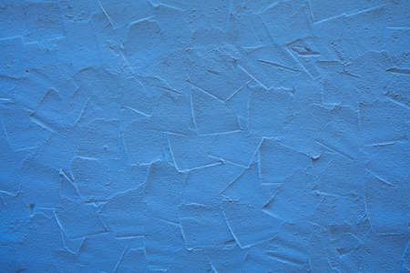 brushed: Rough blue wall surface of decorative embossed painted lime plaster background texture, close up Stock Photo