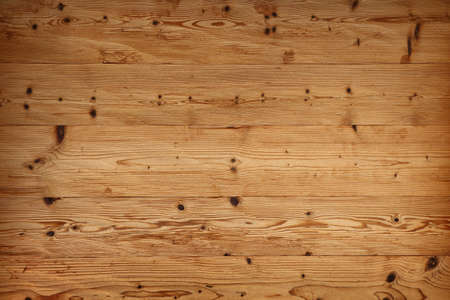 Brown old vintage unpainted wooden horizontal planks wall background texture with aged knotty woodgrain pattern and dark shaded vignette, close up