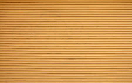 Beige brown painted horizontal metal window roller shutter blinds or garage doors background texture Stock Photo