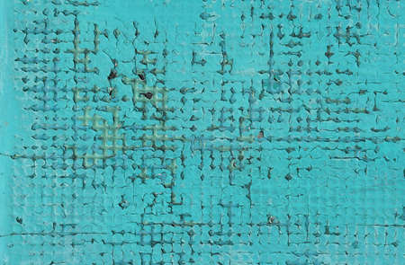 Abstract teal blue background of old vintage grunge colorful wall damaged with defects and different paint layers pattern, close up