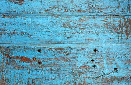 Grunge background texture of blue painted brown wood with dirty stains, scratches, wholes and cracks Stock Photo