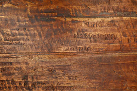 Grunge background texture of brown wood grain with dirty stains, scratches, wholes and cracks