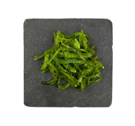 Close up portion of green wakame seaweed salad Stock Photo