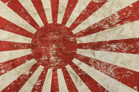 Background of old grunge vintage dirty faded shabby distressed Japan, Nippon flag or historical imperial army Rising Sun flag Stock Photo