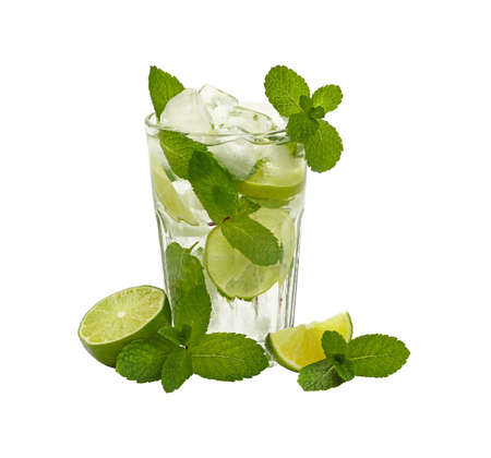 Close up one full, big glass of mojito with mint leaves, lime slices and ice cubes, isolated on white background, high angle side view Stock Photo