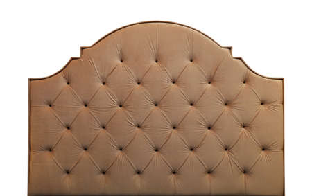 Shaped pastel beige color soft velvet fabric capitone bed headboard of Chesterfiels style sofa isolated on white background, front view