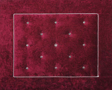 Close up background of purple burgundy color soft velvet bed headboard with rhinestone crystals, front view Stock Photo