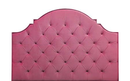 Shaped pastel purple pink color soft velvet fabric capitone bed headboard of Chesterfiels style sofa isolated on white background, front view Archivio Fotografico
